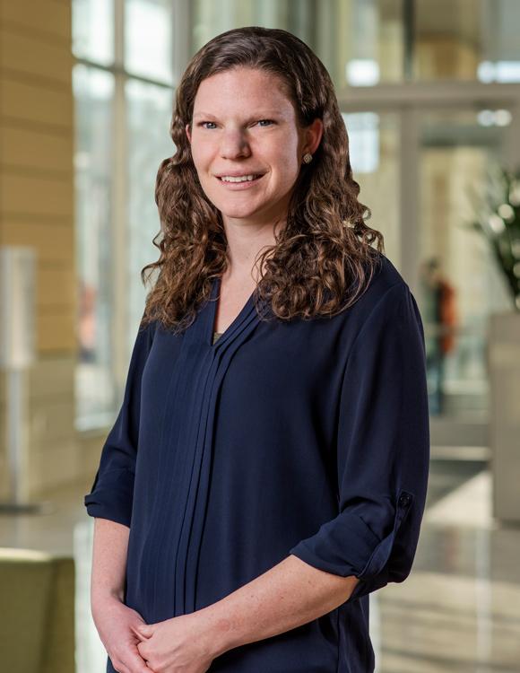Female MBA student poses in buisness school atrium
