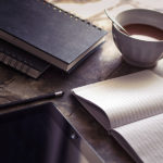 Notebooks, tablet and coffee